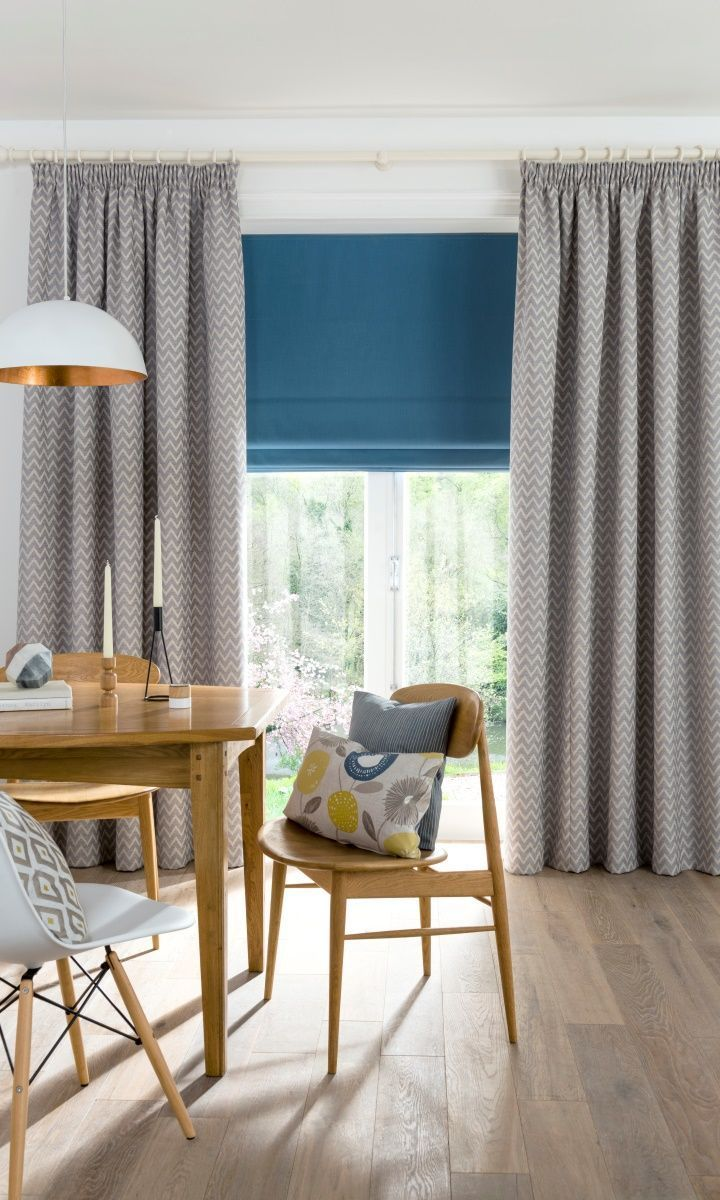 Bring a modern Scandi look to your home by mixing muted patterns with bright pops of colour, add wooden furniture and hints of metallic. Made to measure Romans and Curtains would work wonderfully with this look perfect for living rooms and kitchens.