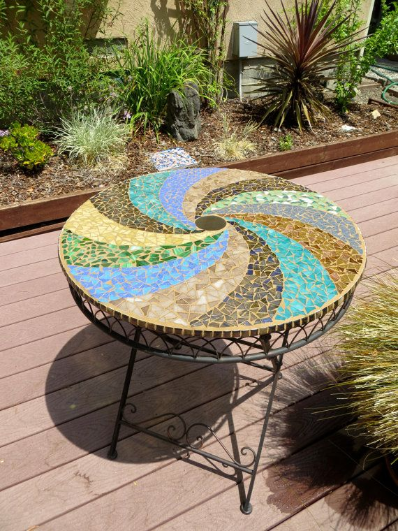 28 diameter x 29 1/2 height mosaic bistro table. This earthy, dynamic piece is set on a sturdy metal base with intricate detailing along the edge and