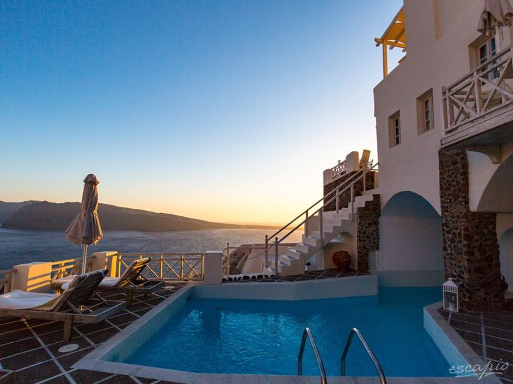 Oia Mare Villas in Oia, Greece: From the property's swimming pool guests can gaze at the sea and enjoy the magnificent sunset views. - #view #greece #sunset #panorama #travel #vacation #escape #trip #destinations #reisen