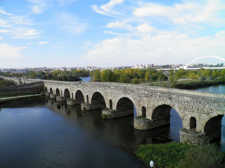 The roman bridge of Augusta Emerita (Mérida,Spain) over the Guadiana River. The original structure was composed of two sections of arches joined at the island in the center of the river. The bridge spans a total of 792 m, making it one of the largest surviving bridges of ancient times