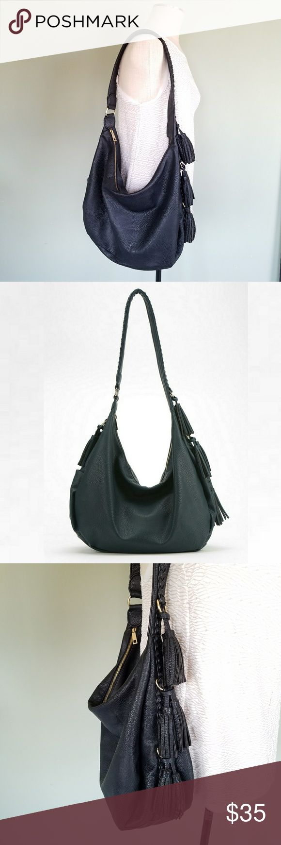 """Urban Outfitters Ecote Braid Strap Tassel Hobo Bag Ecote. Urban Outfitters exclusive. Black slouchy spacious hobo bag.  Pebbled vegan faux leather exterior.  Braided overlay along the strap and sides.  Tassel trim. Polished metal gold tone hardware. Zippered top. Lined interior with a zip pocket. Bag exterior and strap are in excellent condition.  Interior lining is stained and slightly faded. Length: 20"""". Width: 1"""". Height: 13"""". Strap drop: 11.5"""". Urban Outfitters Bags Hobos"""