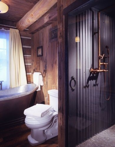 Corrugated tin in the shower with exposed copper pipes in for Copper pipe shower