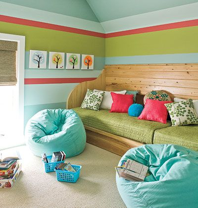 A built-in daybed (sized to fit two twin mattresses) makes a comfy sofa in this kids' playroom and also doubles as extra sleeping for guests or slumber parties. Wood paneling mimics the shape of a traditional sofa, complete with arms and a high back.