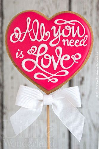 All You Need is Love decorated heart cookie for Valentine's Day or a wedding favor.  Galleta corazon para San Valentin. | Little Wonderland