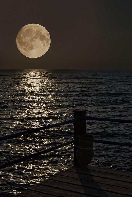 Distant moon photography sky ocean water dock moon
