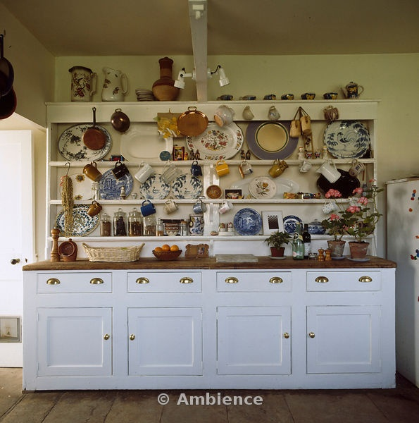 Country Kitchen Dresser: Crockery And Plates On A Large White Painted Dresser In