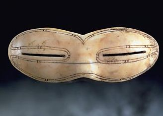 Gatineau, Ontario: World's first sunglasses. Referred to as snow goggles, they were made from bone, leather or wood, designed to protect the eyes from snowblindness caused by bright spring sunlight. The first goggles date back 2000 years to the Old Bering Sea culture, who were the ancestors of the modern Inuit. Snow goggles came to Canada with the Inuit about 800 years ago. This example is from north Baffin, is walrus ivory, made between 1200-1600AD.