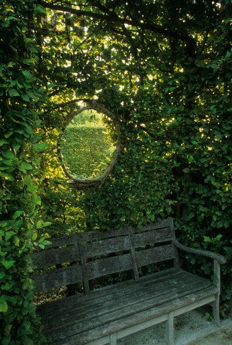 Harpur Garden Images Ltd :: prieu221 Round window in hedge above bench. hedging green seat seats wood wooden view views Jardins du Prieure, Notre Dame d Orsan, France. Hedges Seating Jerry Harpur Please read our licence terms. All digital images must be destroyed unless otherwise agreed in writing. Photograph by: www.harpurgardenlibrary.com Contact: Harpur Garden Library 44 Roxwell Road Chelmsford Essex CM1 2NB, UK