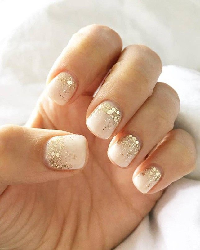Already pining for Christmas? Give your summer nude nails that holiday cheer with a neutral manicure accented with just a touch of gold sparkly glitter.