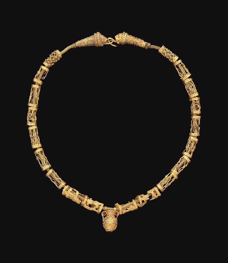 """ancientjewels: """" Hellenistic period Greek gold necklace featuring an amphora-shaped pendant and lion-head terminals at clasp. Circa 3rd-2nd centuries BCE. From Christie's Auctions """""""