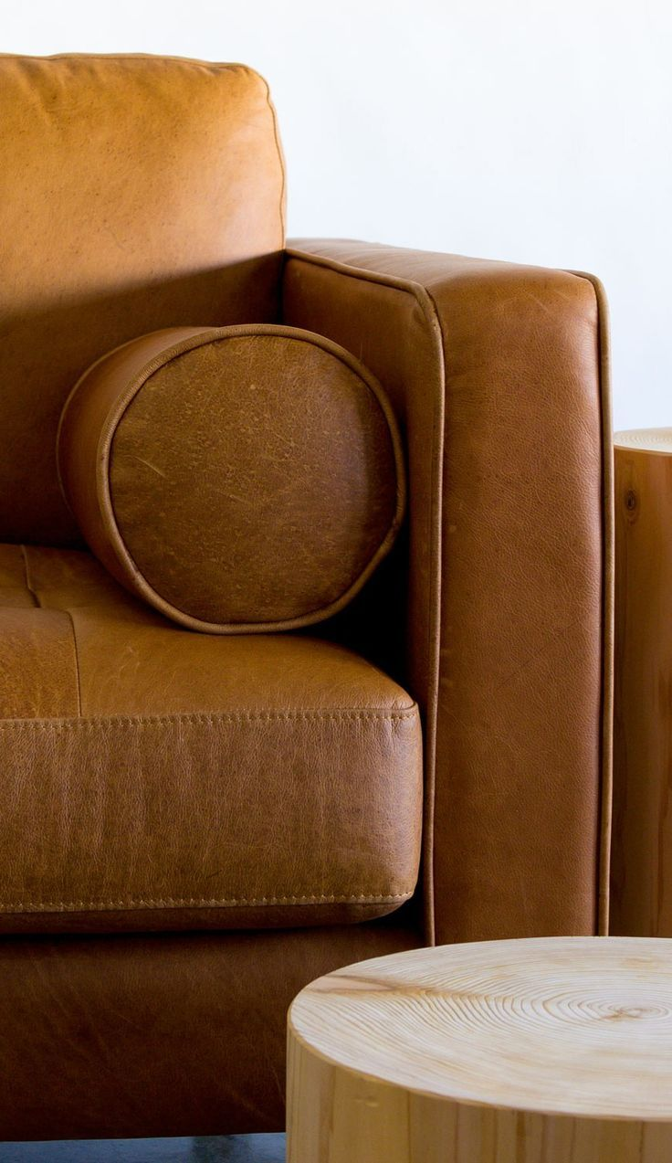 Natural color variations, wrinkles and creases are part of the unique characteristics of this genuine leather couch.