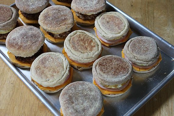 Breakfast sandwiches in large quantities - good for family trips and easy to make ahead! Also can work well for a mixed (veg & meat eating crowd)