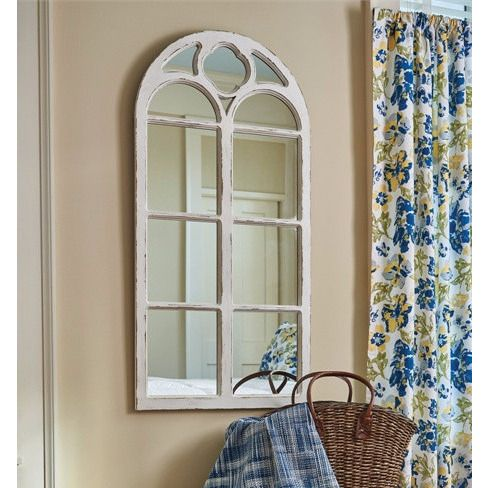 """This window inspired mirror has distressed white finish and an arched top. Made from wood and glass, this is a lovely addition to any wall. Accessories not included. Dimensions: 47.25"""" height x 23.5"""""""