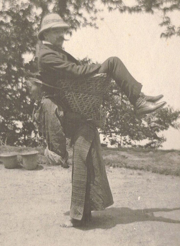 A Sikkimese woman carrying a British man on her back, West Bengal, India, 1900