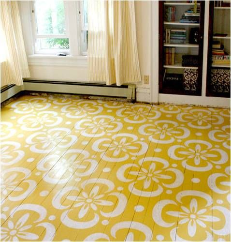 pattern and color inspiration to brighten a room and revamp worn wood floors. note: ugly baseboards don't look so bad alongside pretty stenciled floor!