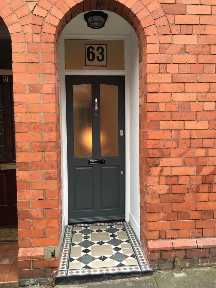 Front door painted in Farrow and Ball Downpipe. Floor tiles from Topp Tiles