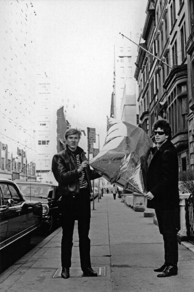 Pop artist Andy Warhol and rock artist Lou Reed pose for a portrait with one of Warhol's iconic pop sculptures, a helium filled silver pillow entitled Silver Clouds, in March 1966 in New York City.(Photo by David Gahr)