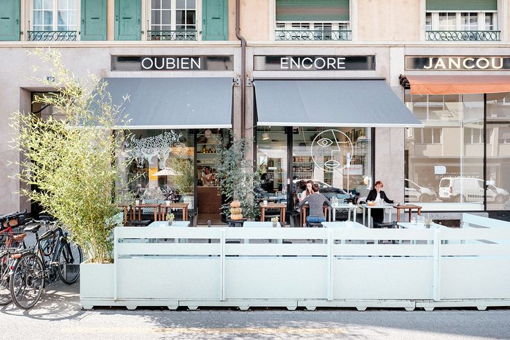 A view of the sunny terrace in relaxed pastel tones, Ou Bien Encore Geneva.