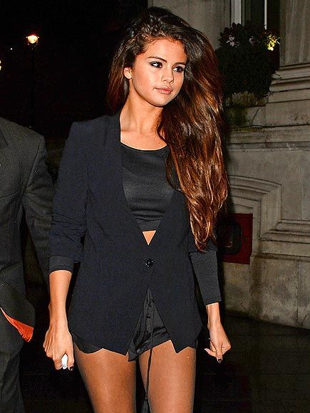 Star Tracks: Tuesday, February 18, 2014 | NIGHT WALK | Looks at those legs for days! Selena Gomez sports some short-shorts while out in London Monday night.