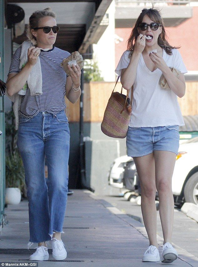 Tiny treat: The 26-year-old and her pal enjoyed a taster of frozen yogurt as they strolled...