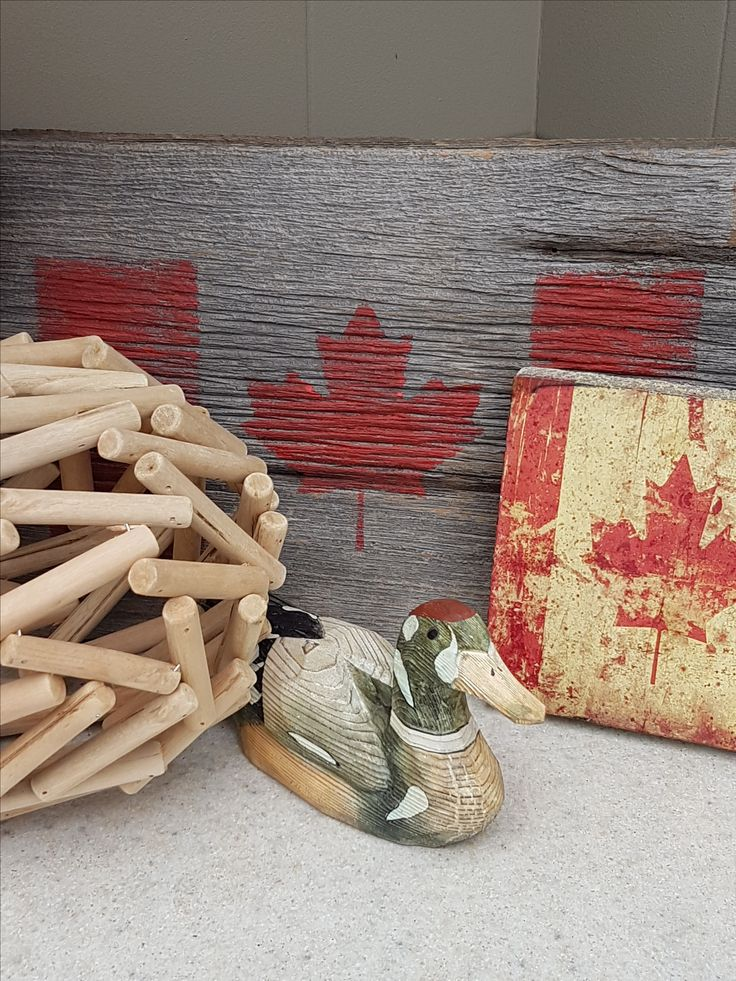 Hand painted duck and Canada flag on barn board