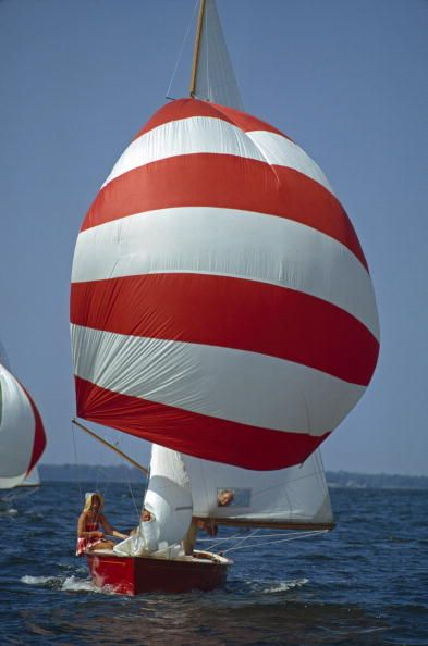A red-striped spinnaker billows on Lightning-class sailboat, Choptank River, Maryland. 1963