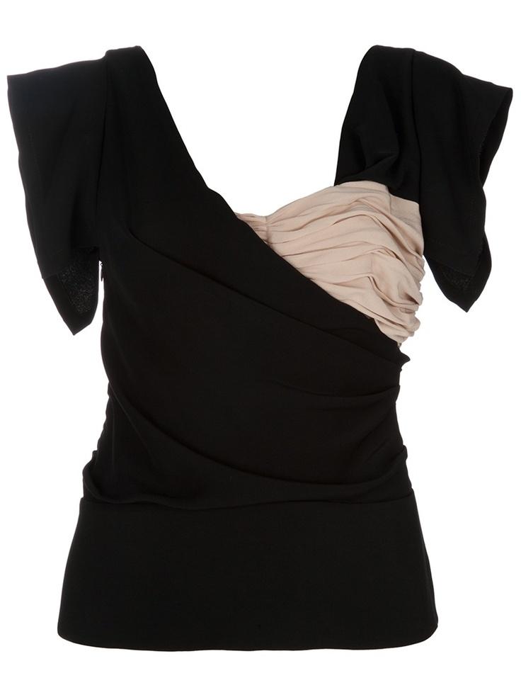 Blusa vintage preta em seda. - Descubra as últimas tendências da moda no lookmoderno.com.br