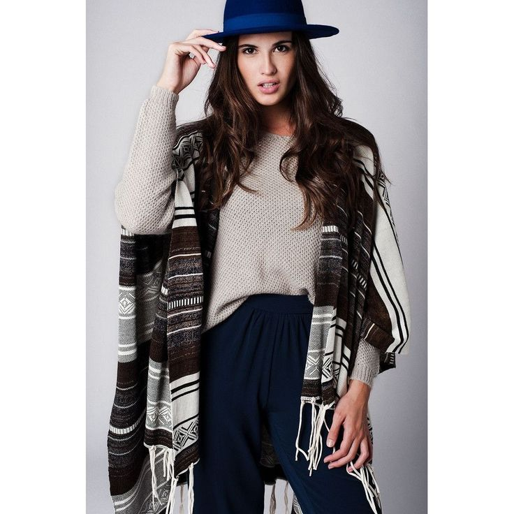 A Printed Knitted Poncho With Fringing