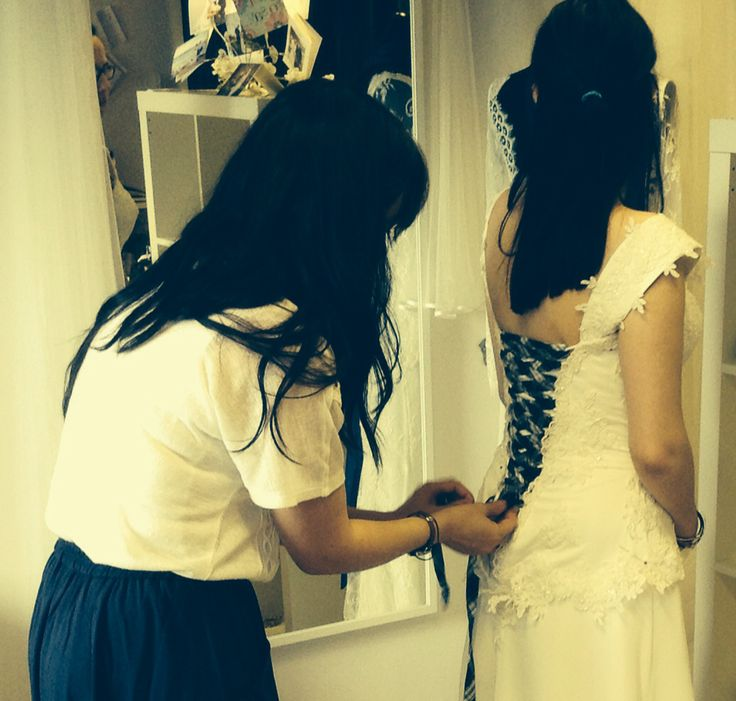 Gemma Sargent: Fashion Designer & Couturier - lacing of a contrast lace up back during the first fitting of a Gemma Sargent couture bridal gown