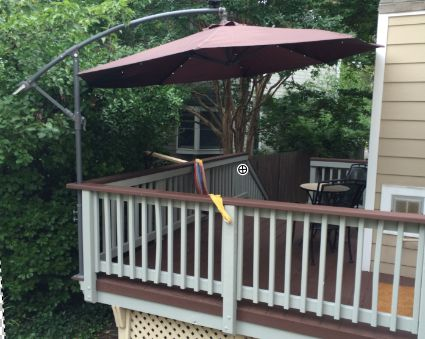 mount a cantilever umbrella outside the deck rail to save valuable deck space