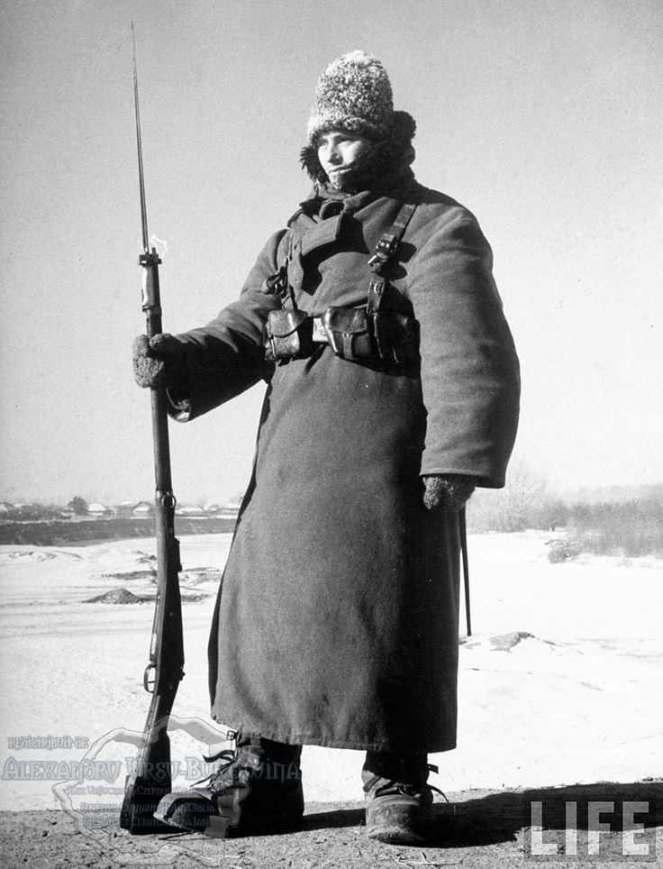48.Tighina.Rumanian Army guard, clad in cold weather gear, during sentry duty on the bridge over the frozen Prut River in 35 degree-below-zero weather which makes it impossible for him to be on more than an hour at a time.
