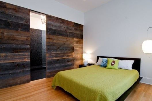 So except for the fact that this is a bedroom, I love the idea of the wood wall as an accent wall in a living space