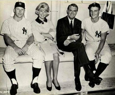 Doris Day & Cary Grant in the dugout with Yankee players Mickey Mantle & Roger Maris during filming That Touch of Mink