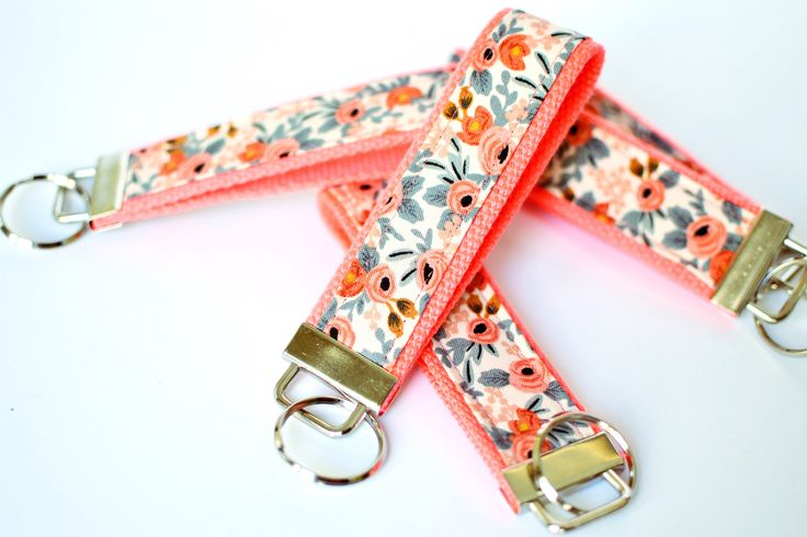 Coral Key Fob Wristlet, Shower Favor, Floral Key Chain, Rifle Fabric Keychain Wristlet, Fabric Key Holder, Sorority Gift, Pink Key Lanyard by DaisyFayeDesigns on Etsy https://www.etsy.com/listing/485151459/coral-key-fob-wristlet-shower-favor