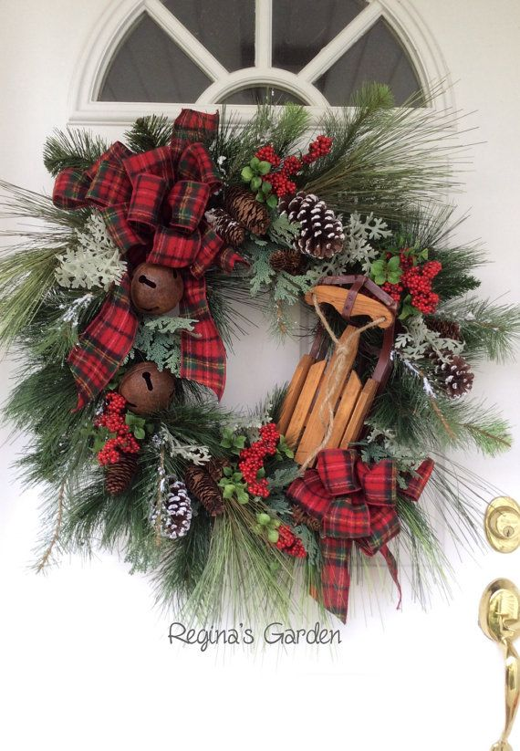 I love this rustic plaid sled, sleigh bells and pinecone wreath!
