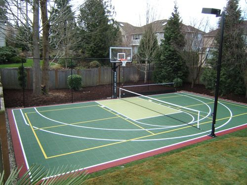 Pickleball (it's a Seattle thing!) and basketball court combo with lighting.  Pretty dreamy, if you added a hip wall for seating.  Might be perfect for our lower yard.