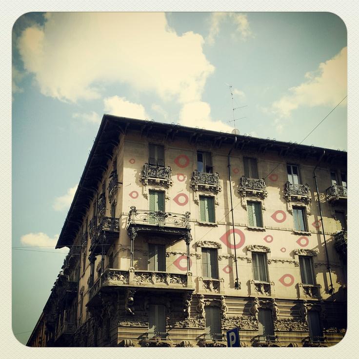 Something strange appeared on a Liberty facade at Porta Venezia!