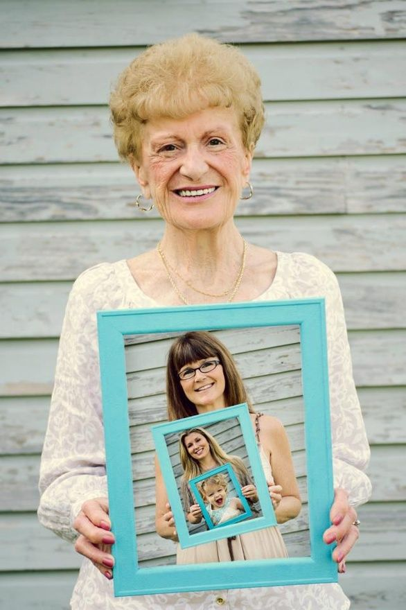 Family Portrait - This simple and creative idea is perfect for a family portrait. Note: The use of the colored frame, neutral tone clothing, and the solid background - this draws the viewer's eye to each person's face. The pairing down is important and makes this composition work. We should so do this Kristen... mom, me, you, and lexi ;-)