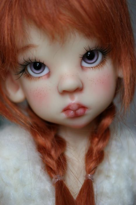 Beautiful....made of polymer clay//// cute dolls. don't think I could make one but i put it in my pinterest: