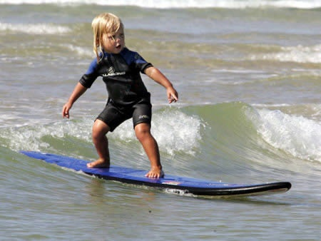 Jaylan Amor is only two years old, but is already surfing the waves outside of Brisbane, Australia, and has secured multiple endorsements from surf shops. To catch a wave, his dad paddles him out to sea, then the two year old hops and rides the waves back into shore. Mr Amor isn't worried if Jaylan falls, as the tike just swims back to his board and waits for daddy to help him back up.