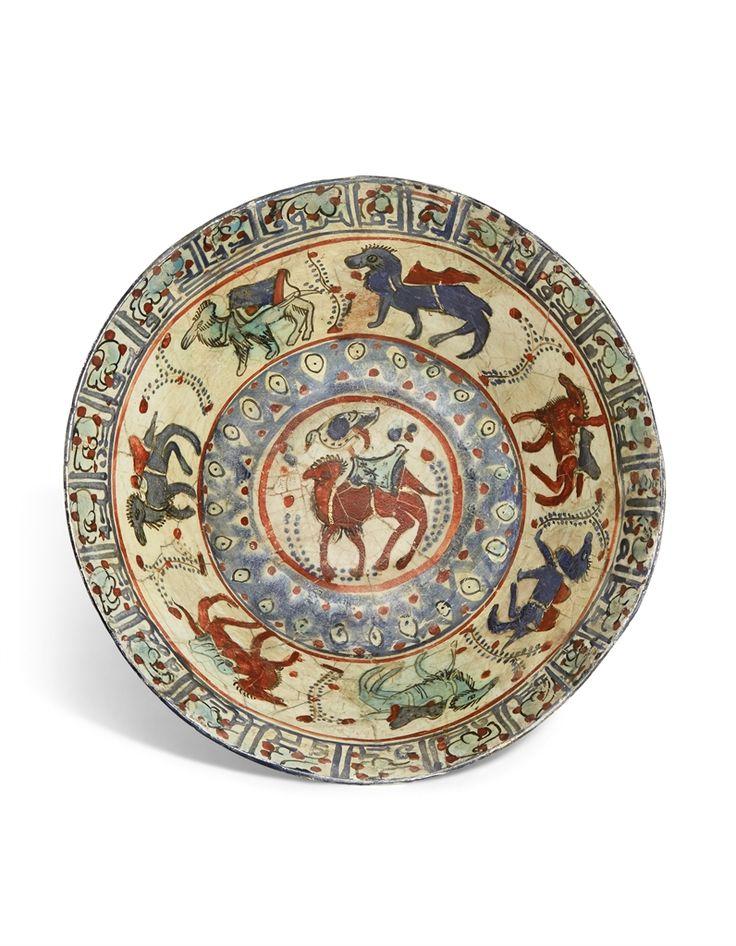 A SELJUK FIGURAL MINA'I POTTERY BOWL - IRAN, LATE 12TH/EARLY 13TH CENTURY.