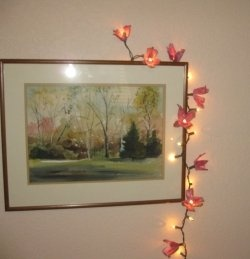 For an inexpensive way to brighten a room (literally), make egg carton flower lights. This simple recycled craft is easy to make, cheap, and beautiful!    These...