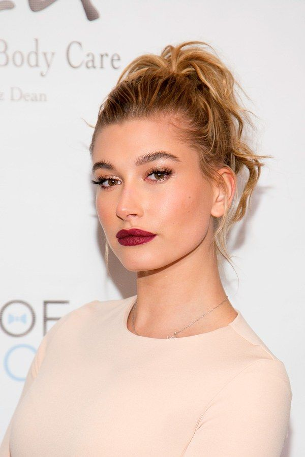 Though her makeup is nothing short of noteworthy, Hailey's really become known for her dressy ponytails. She even made one work for a Beverly Hills gala, with curled hair, a dark matte lip, and majorly long lashes.