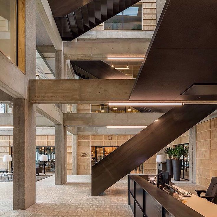 Dutch firm Studioninedots has renovated a 1970s office building in the Dutch city of Hilversum removing sections of the existing walls and floors to create a four-storey void crisscrossed by steel staircases.  See a full set of images on http://ift.tt/1JaUmoj #architecture #staircase by dezeen