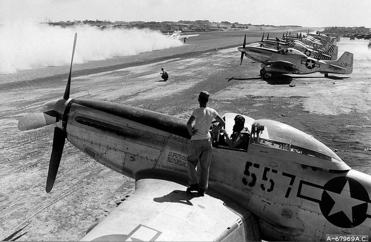 North American P-51 Mustangs before taking off from the airfield of the island of Iwo Jima - 1945