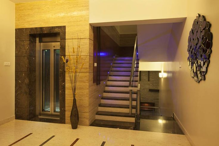 Marble And Wooden Cladding On Lift And Staircase Wall On