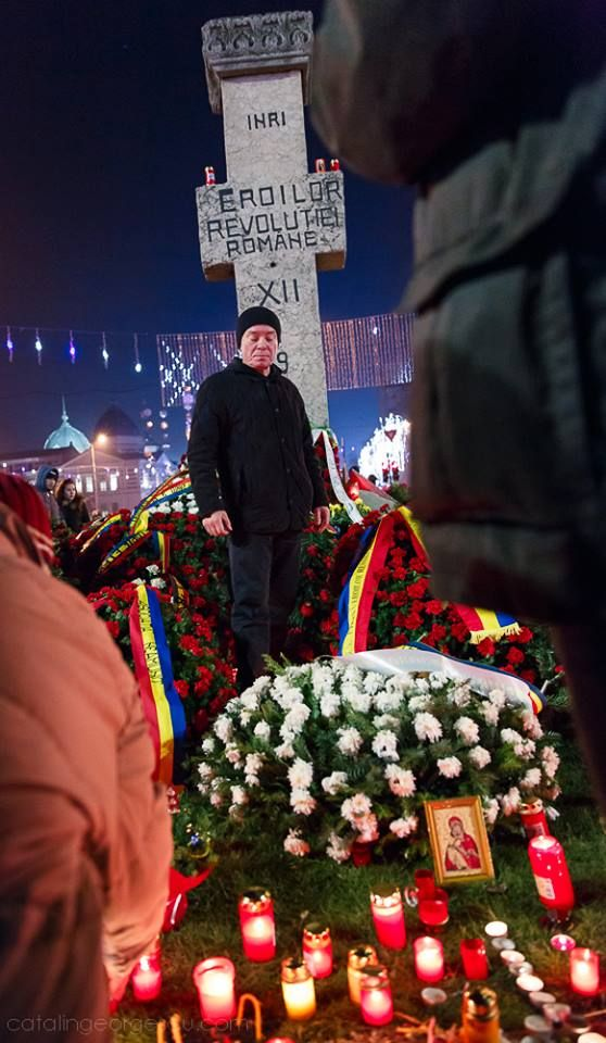 """Downtown Bucharest, Romania,  Protesters bring homage to the heroes of the Romanian Revolution of '89. Many young men and women died in University Square 21 December 1989. People shouted that their revolution has been stolen and their blood must be avenged. """"Shame for the spilled blood"""""""