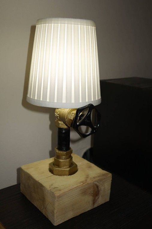 Hand made lamp made from an old water pipe.