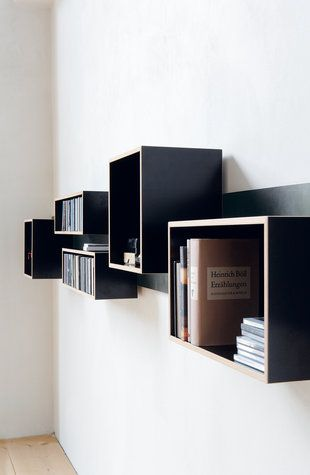 Magnetique (Swen Krause)  A metal sheet, mounted horizontally or vertically on the wall provides an endless variety of possibilities: boxes with a magnetical back stick on it in any position.
