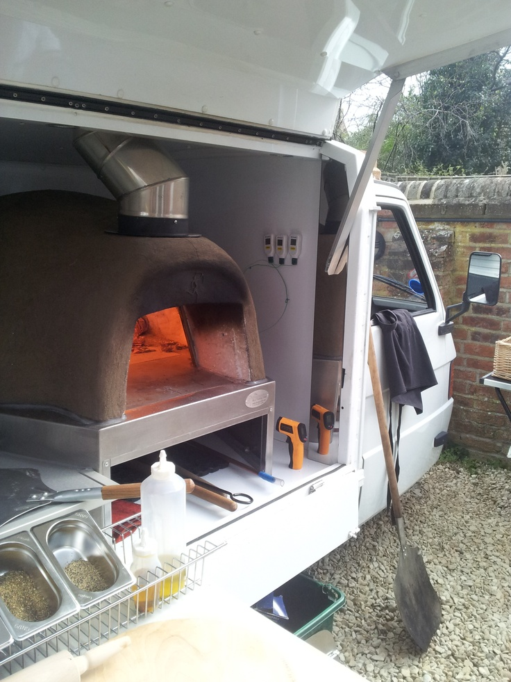 Secret Pizza Society's Piaggio Ape with wood fired oven mounted inside it.